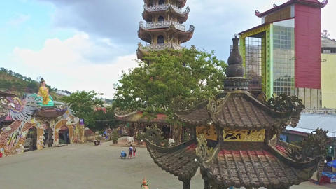 Drone Shows Majestic Buddhist Temple Complex against Sky Hills Footage