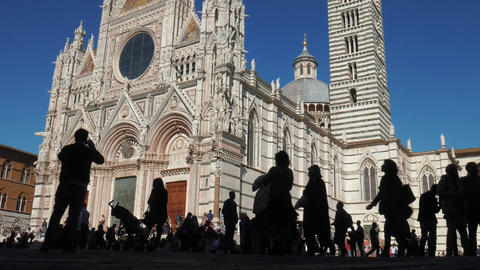 Silhouettes of people passing in front of Siena Cathedral Footage