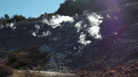 Backlit fumaroles with steam coming out from the ground Footage