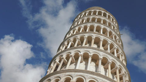 Low angle timelapse of famous leaning tower of Pisa, fast moving clouds Footage