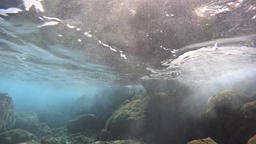 Underwater waves over rocks Footage