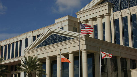 Flags in Front of Courthouse in Jacksonville, Florida Live Action