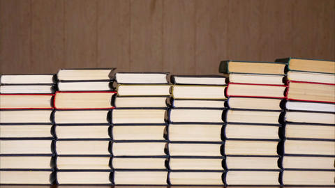 Books timelapse. Stacked books on wooden background Filmmaterial