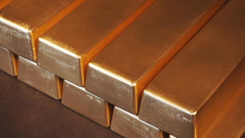 Gold bullion bars. Moving Stacks Of Gold Bars Live Action