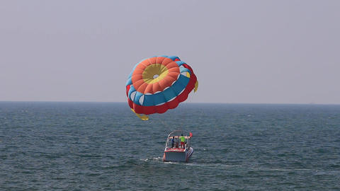 Tourists para sailing in the sea, Goa, India 影片素材