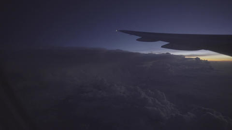 View of clouds and sunrise from aircraft window Filmmaterial