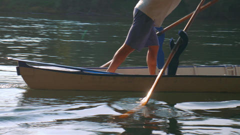 Man rowing in Valesana style with two oars on Ticino River, Italy Footage