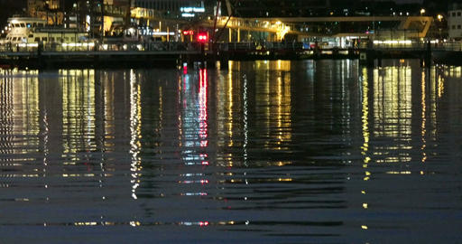 Reflective Night Lights on a Water Surface on the Kiel Week Festival in Germany Footage