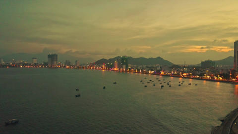 Drone Shows Evening City on Seaside against Sunset Footage