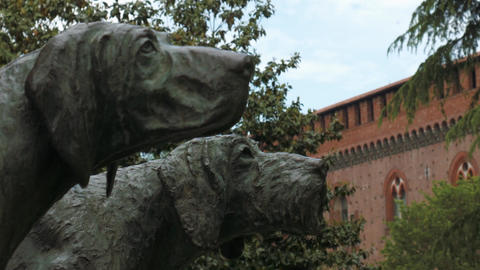 Hounds monument with castle in the background, shift focus, in Pavia, PV, Italy Footage