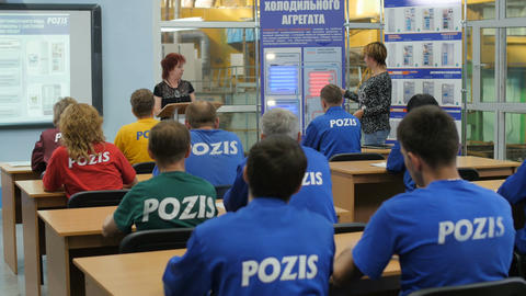 People in Bright Color Pozis Uniform Sit and Listen to Lecture Footage