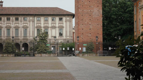 Medieval clock tower seen from university courtyard in Pavia, PV, Italy Footage
