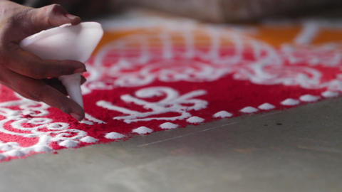 Rangoli with coloured powder being created by Rangoli artist Footage