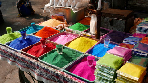 4k footage of Bowls of vibrant coloured dyes and Rangoli mixed with colours Footage