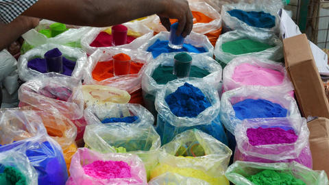 4k footage of Bowls of vibrant colored dyes and Rangoli mixed with colors Footage