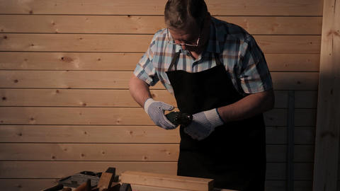 Senior carpenter preparing to work Footage