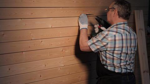 Senior carpenter tighten the screw Footage