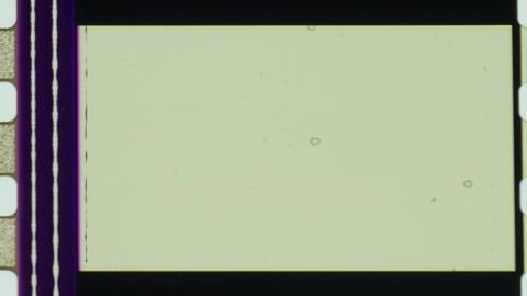 Film strip filmstrip 35mm reel cinema old vintage dirt dust edges scratches 4k Footage
