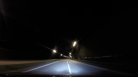 Driving fast in a car on highway at night Footage