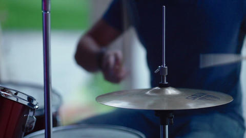 A man plays on a drum set Footage