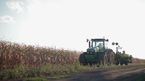 Tractor on the road with seeding carriage Footage