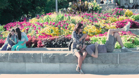 Mature Couple Relaxing In A Public Park stock footage
