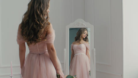Beautiful bride with the bouquet near the mirror Footage