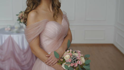 Beautiful brunette girl wearing pink wedding dress Footage