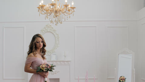 Beautiful brunette girl wearing pink wedding dress Footage