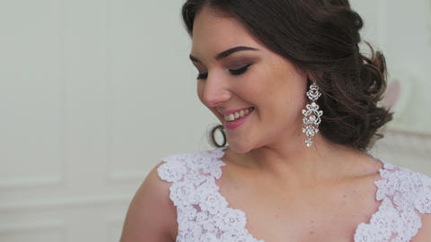 Smiling happy bride portrait against white hall background Footage