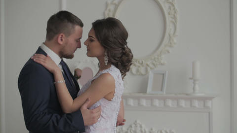 Happy groom and bride. Happy and cheerful wedding couple showing tender feelings Live Action