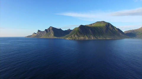 Flying over ocean by scenic Lofoten coastline Footage