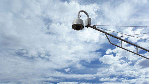 Surveillance Camera Against Timelapse Clouds Footage