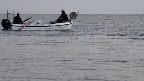 Boat with two fishermen move in the early hours of the morning to place fishing Footage