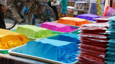 4k footage of Bowls of vibrant coloured dyes and Rangoli mixed with colours Live Action