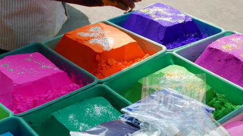 4k footage of Bowls of vibrant colored dyes and Rangoli mixed with colours Footage
