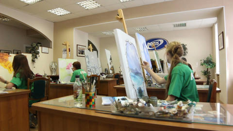 Camera Shows Young People in Pozis T-shirts Painting Footage