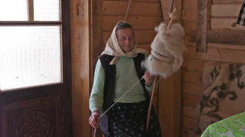 a woman spinning wool in Romania Footage