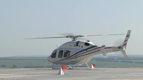 Helicopter Prepares to Take Off on Large Asphalt Runway Footage