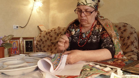 Portrait of grandmother in national clothes embroideries with beads orthodox ico Footage