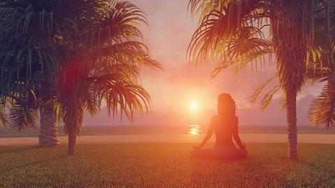 Woman in meditation yoga lotus pose on beach at sunrise or sunset 画像