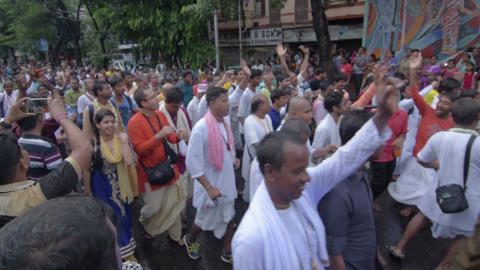 Devotees dancing a spiritual dance , on Rath yatra in Kolkata city Live Action