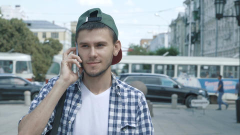 Young handsome man talking on the phone Filmmaterial