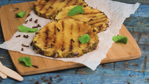 Grilled pineapple slices Footage