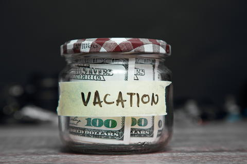 Jar and dollars with text VACATION Fotografía