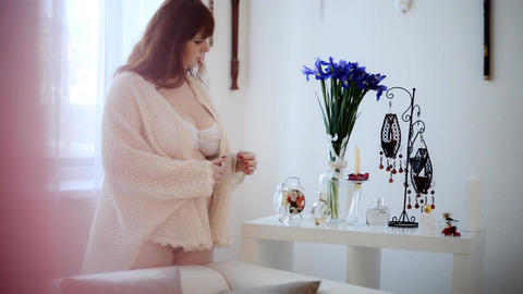 Sexy chubby woman in lingerie lights a candle Stock Video Footage