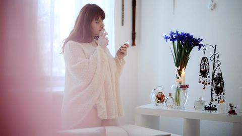 Sexy plus size woman sniffs perfume Footage
