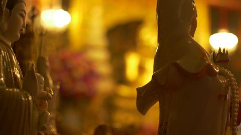 Guanyin or Guan Yin East Asian bodhisattva Statue in Temple at Wat Phanan Choeng Footage