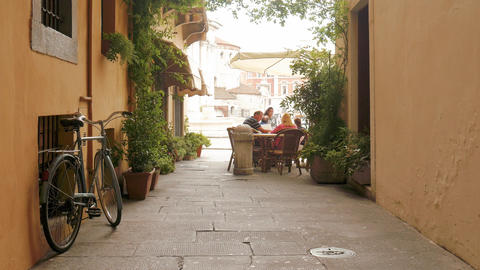 Brescia – Italy: People eating in a typical alley in Italy Footage