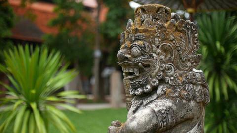 Balinese Carved Stone Statue of Rakasa Hindu Temple in the rain Footage